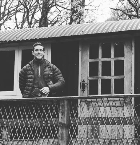 ben outside shepherd's hut