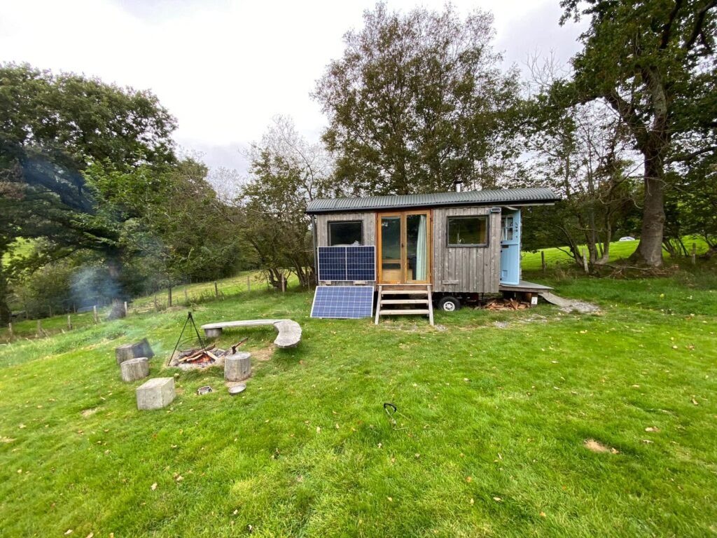 shepherds hut with pv solar panels in countryside