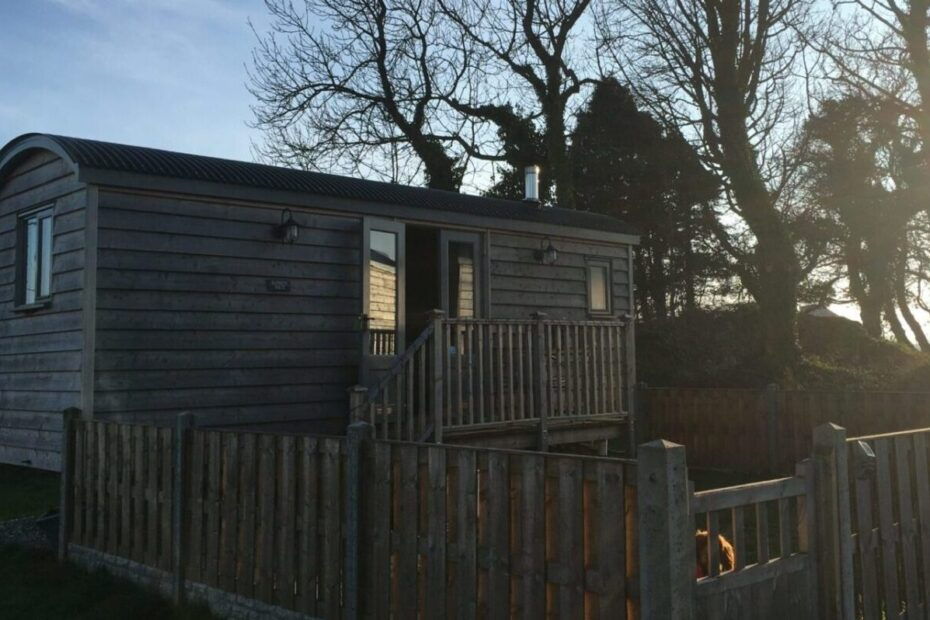 benllech shepherds hut with trees in the background