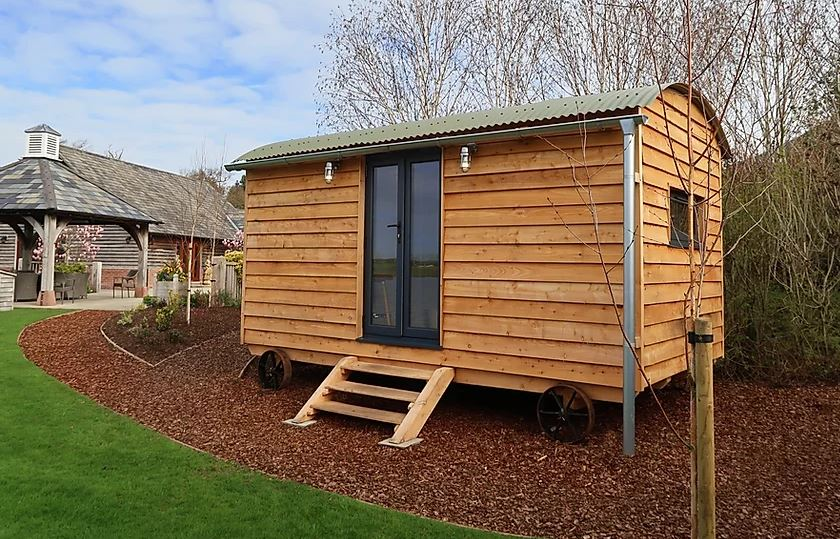 commercial timber clad shepherds hut with steps and glass doors