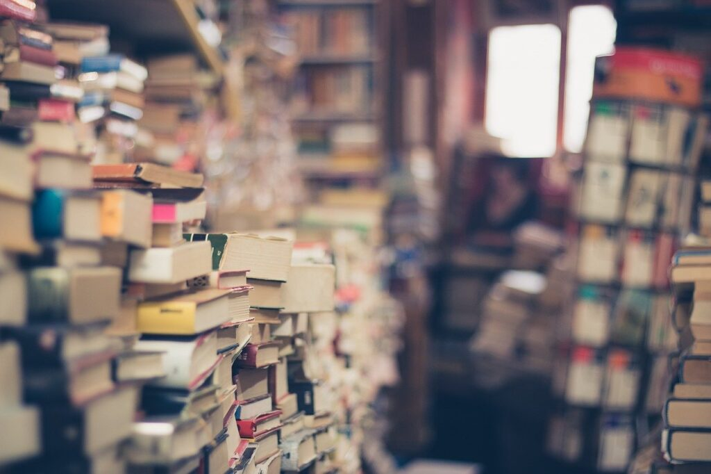 large stack of second hand books for sale