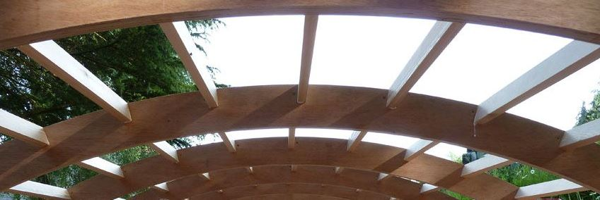 Slot joints used to connect several full length beams and curved spars