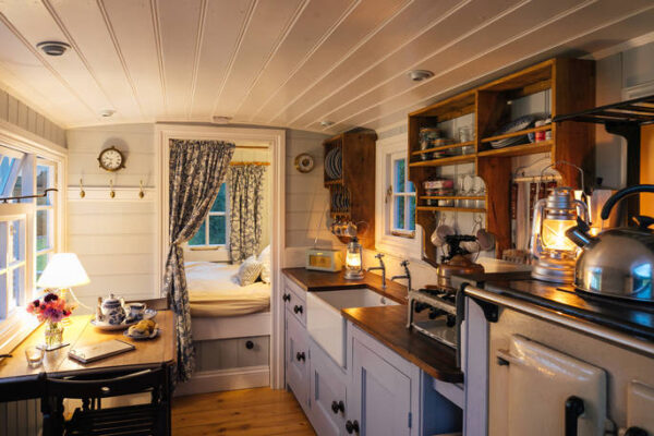 pristine interior of commanders caravan with kitchen and double bed