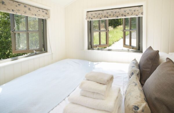 rowan retreat shepherds hut in cumbria double view bed for a cosy winter holiday