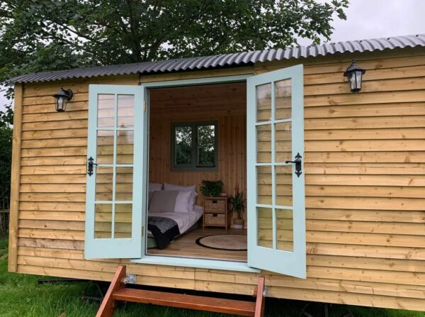 timber clad midnight shepherds hut in north wales for sale