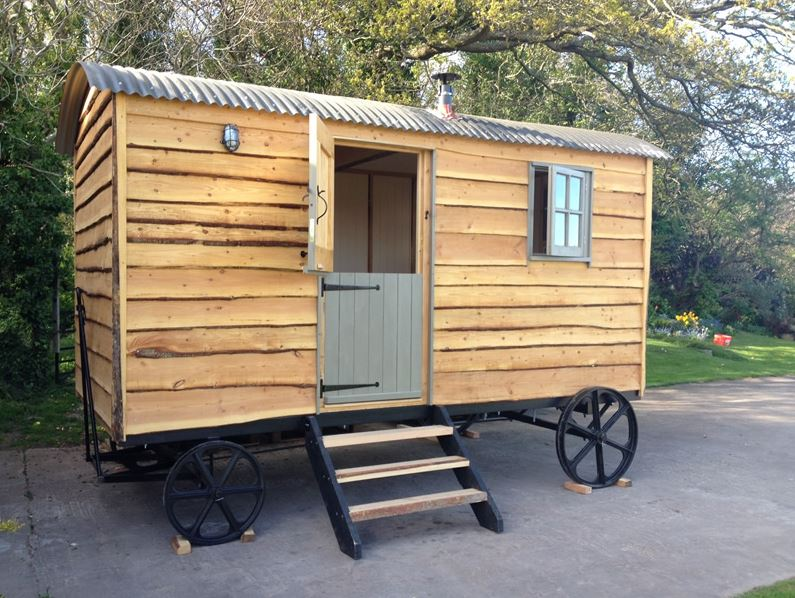 view of the outside of quirky huts shepherd hut for sale in wales