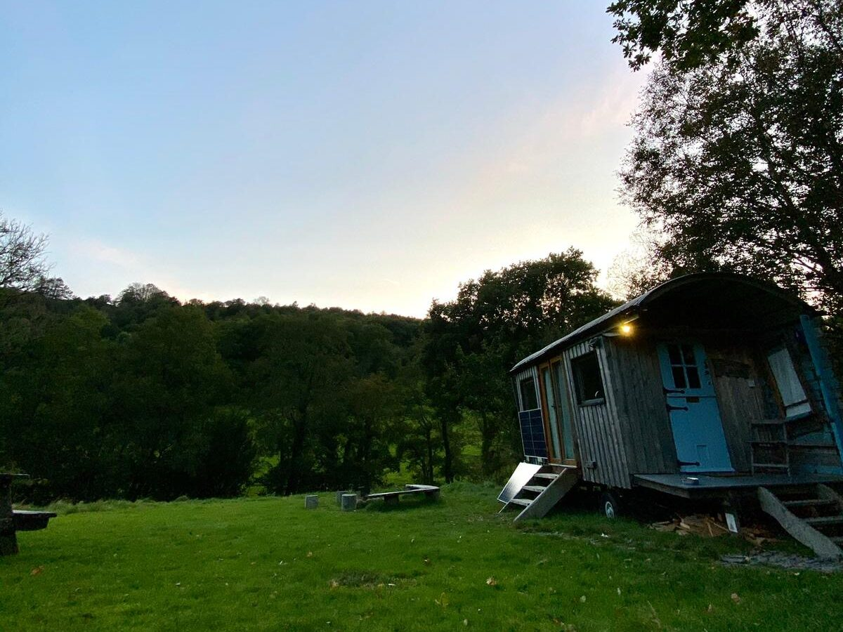 off grid hut in wales field next to forest