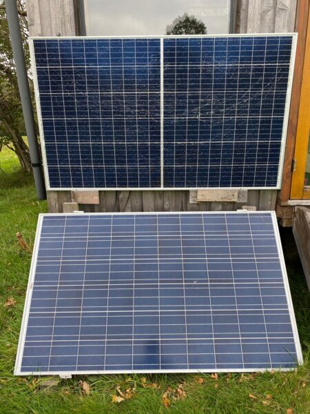 solar photovoltaic panels facing the sun to power an off grid hut