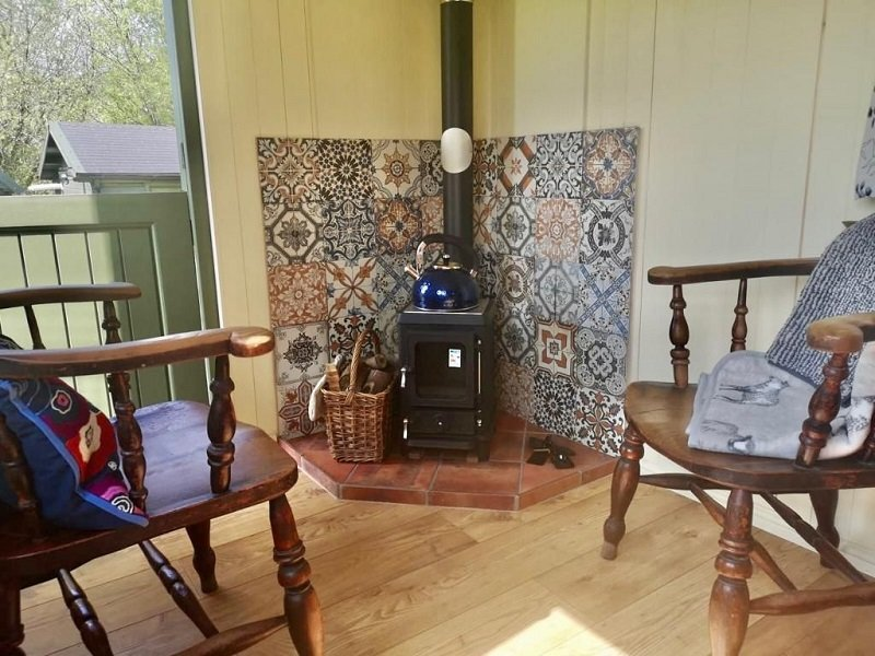 stockman shepherds hut for sale  in wales view of the inside log burner
