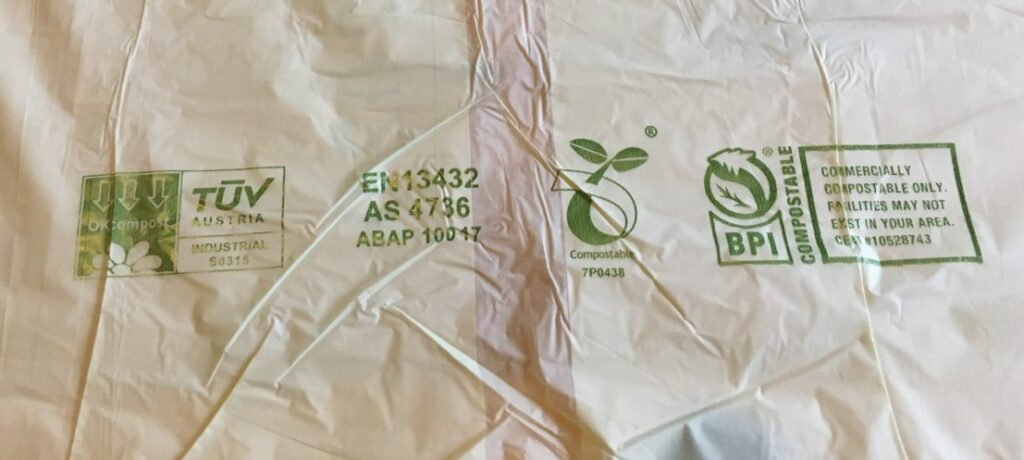 compost logos on a compostable food waste caddy liner bag