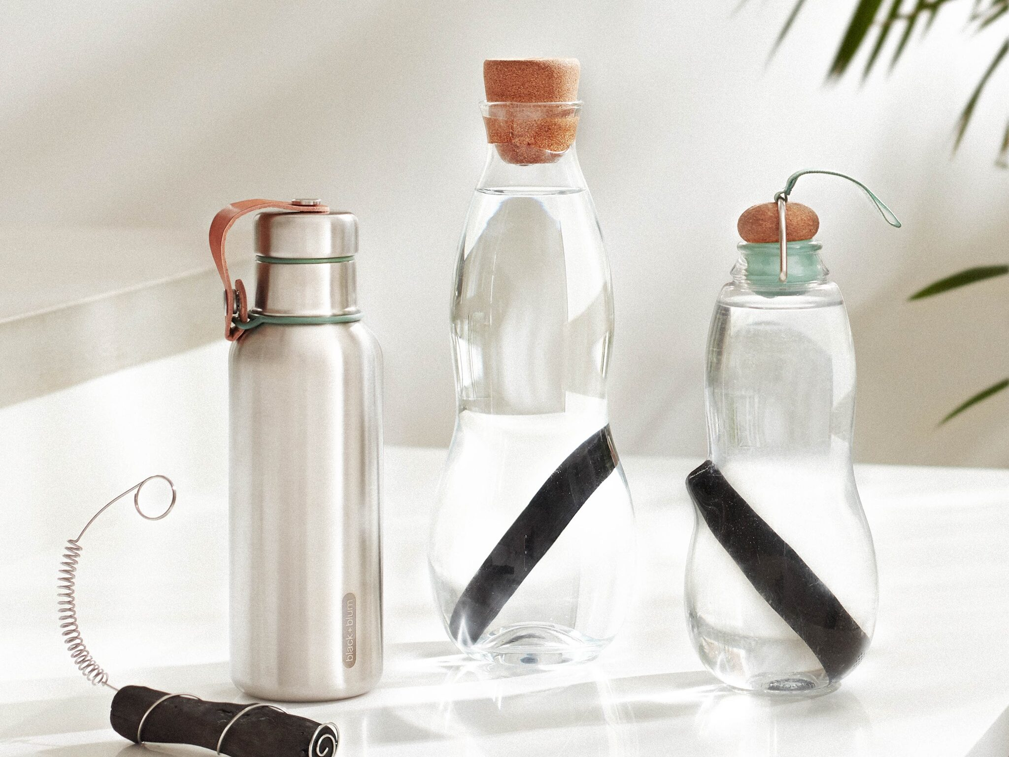 three water bottles with activated charcoal