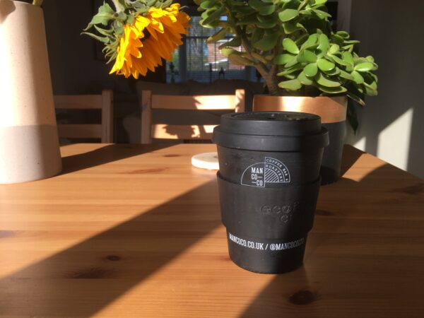 black ecoffee cup on wooden table