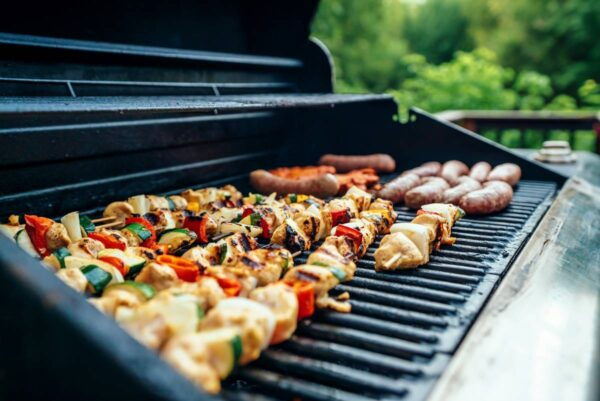 large gas bbq with food on