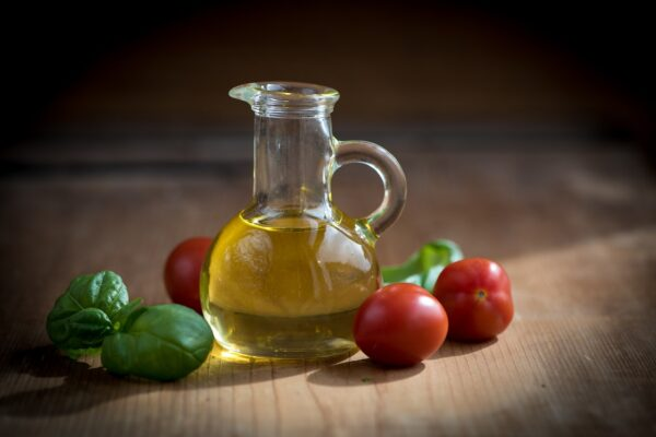 glass jar with olive oil in